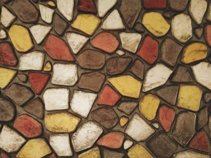 A wall built of multicolored stone