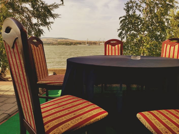 Four chairs on the terrace of the restaurant